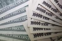ドル調達コストが急低下、日本勢の外債処分と円短期金利上昇で