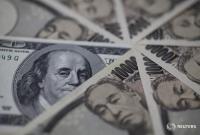 ドル100円後半、日銀総裁発言受け株安・円高