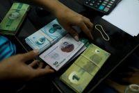 ベネズエラの貧困地区で独自通貨発行、現金不足に対抗