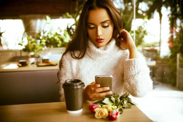 beautiful Woman using her smartphone.
