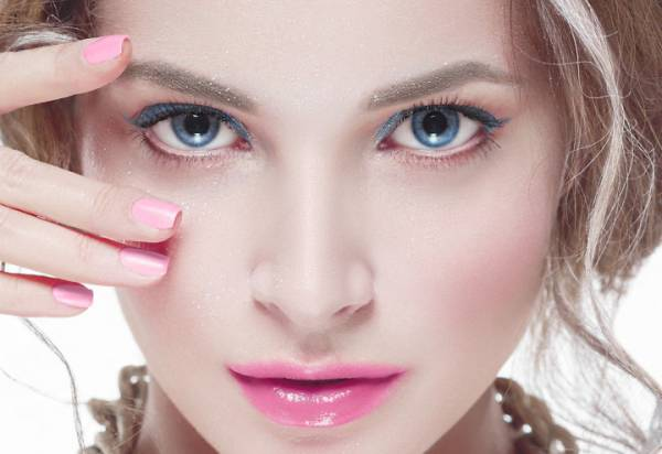 Beautiful woman young model with pink lips and pink manicure