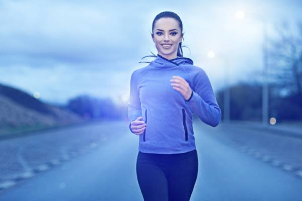 woman jogging outdoors in the evening