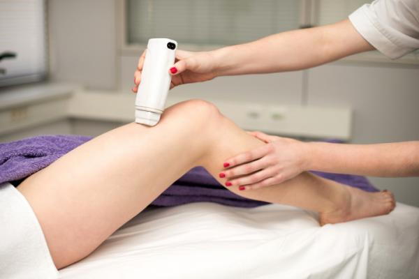 Hair removal cosmetology procedure from a therapist at cosmetic
