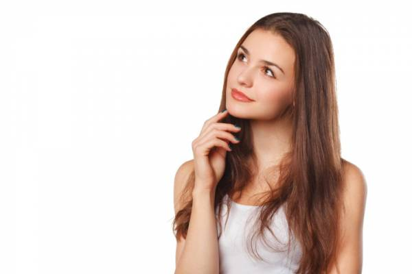 woman thinking looking to the side at blank copy space