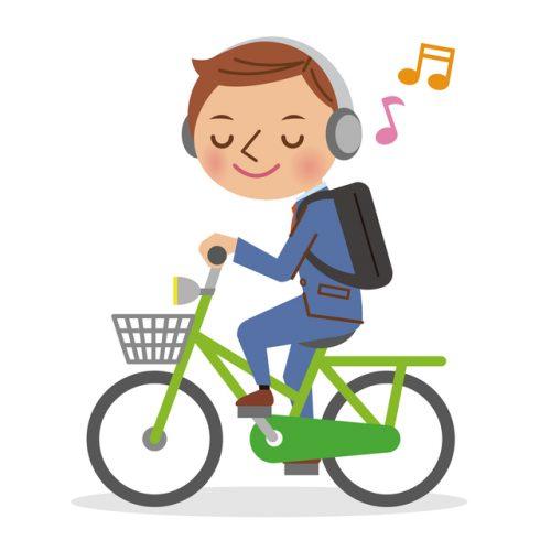 イヤホンで音楽を聴きながら自転...