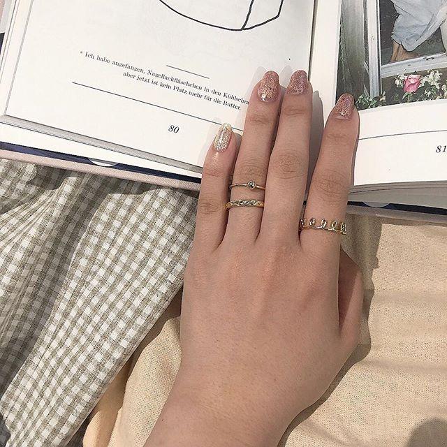 左 人差し指 指輪